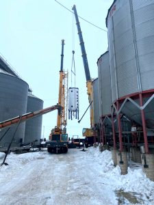 The conditioner being set down outside the plant. This image shows the 270 ton crane with the 75 ton crane used to tail the load